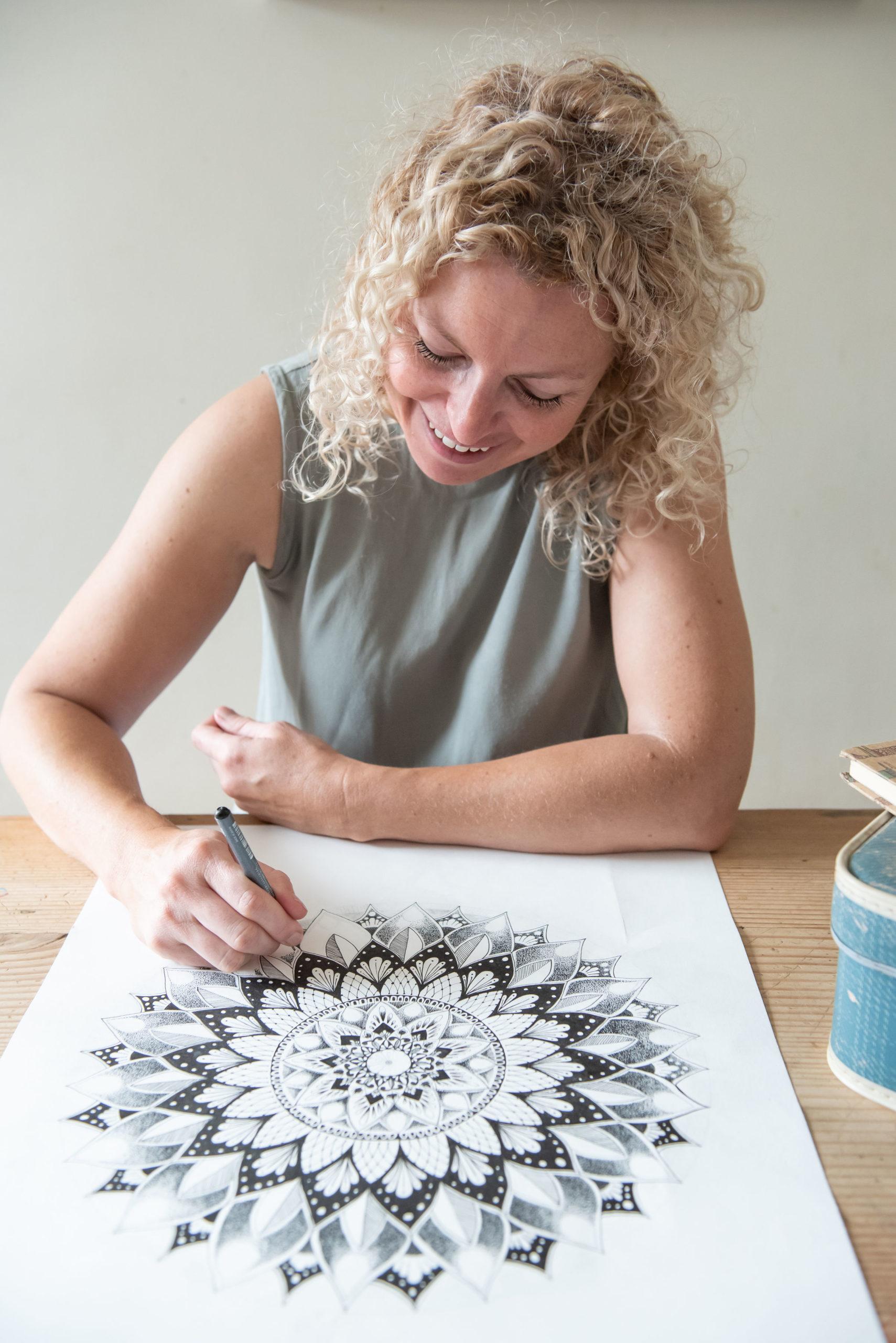 Kylie drawing a mandala