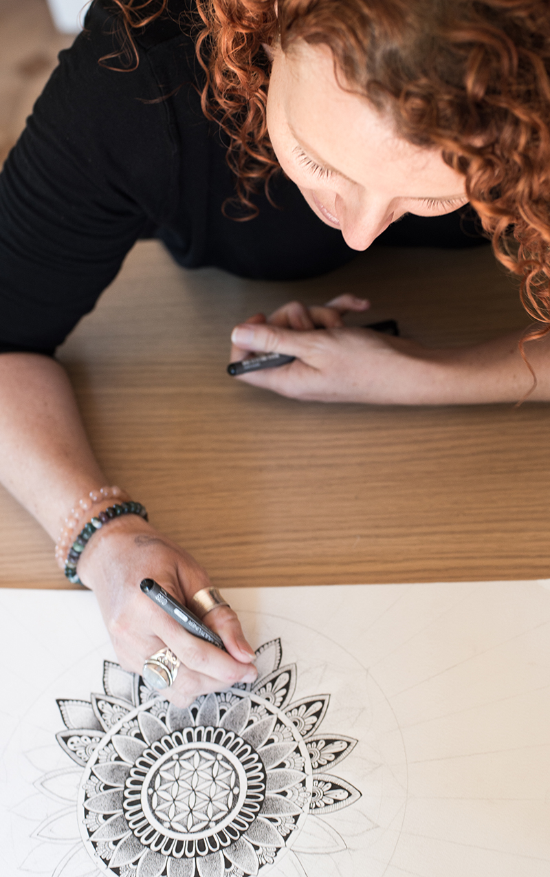 kylie martin drawing at her desk