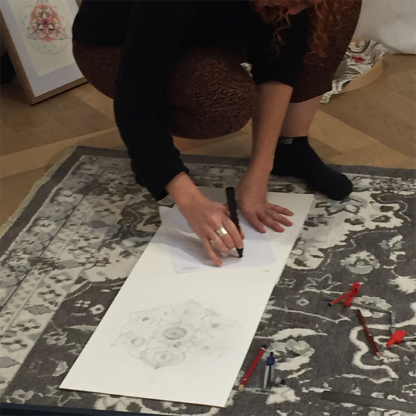 looking at the mockup of the wall mandala on the sketch paper