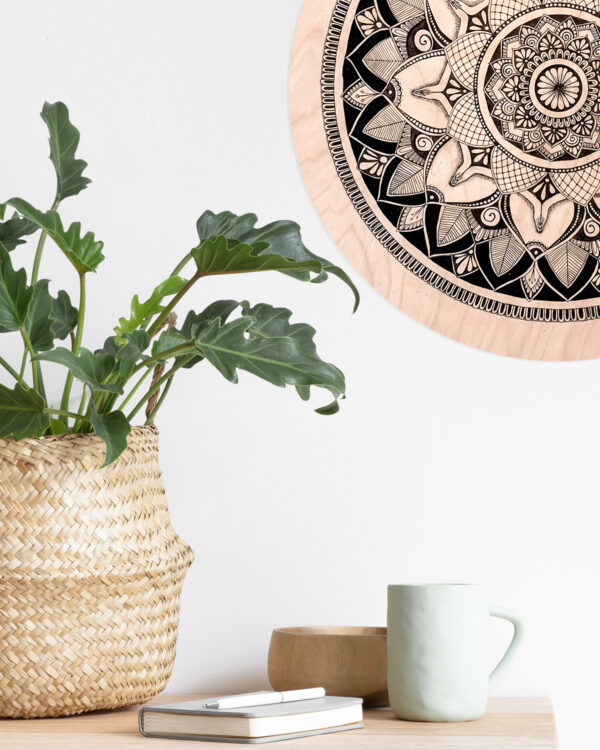 wooden mandala hanging on the wall
