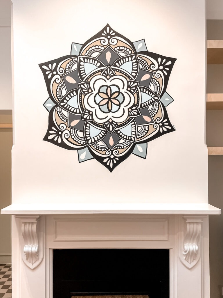the finished mandala on the wall above the fire place at the good hub