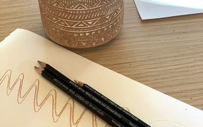 kylie laid out her 3 derwent pencils on the desk